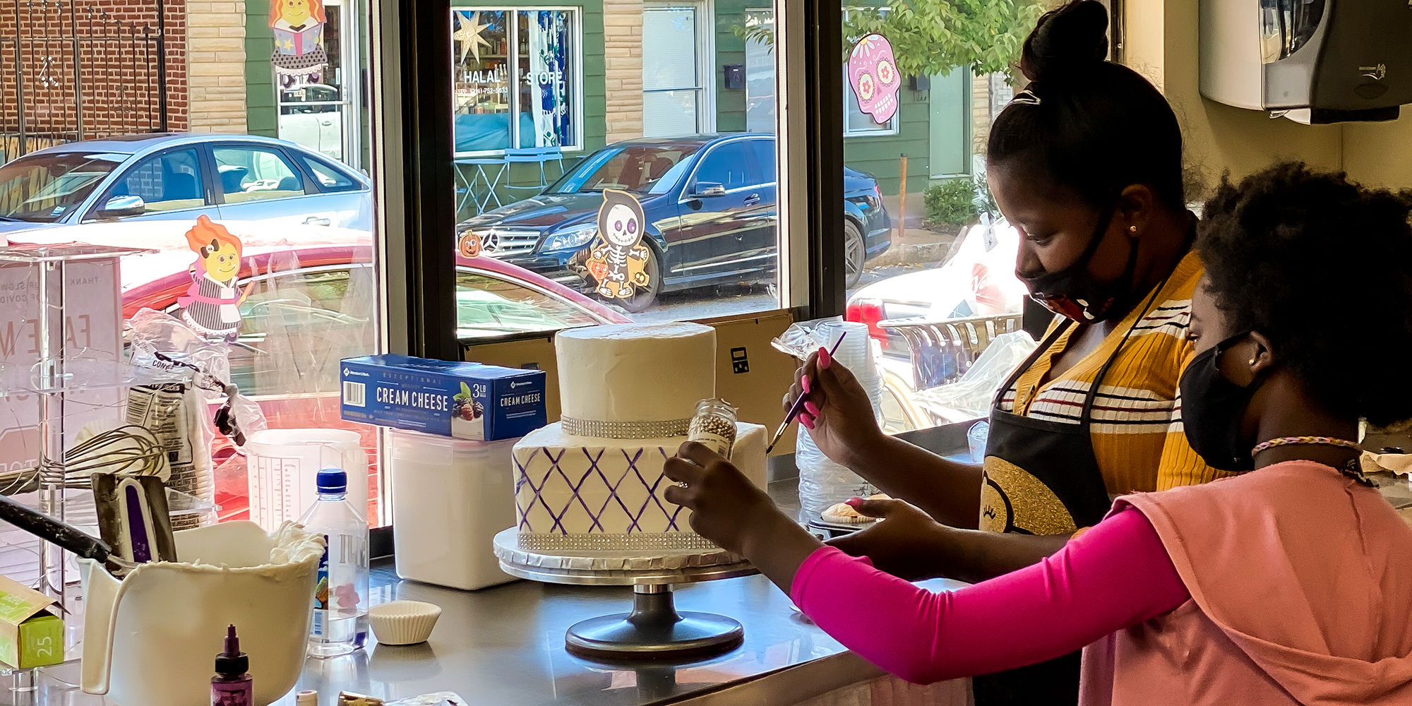 Cake decorating at Pies and Surprise in Downtown Dutchtown, St. Louis.