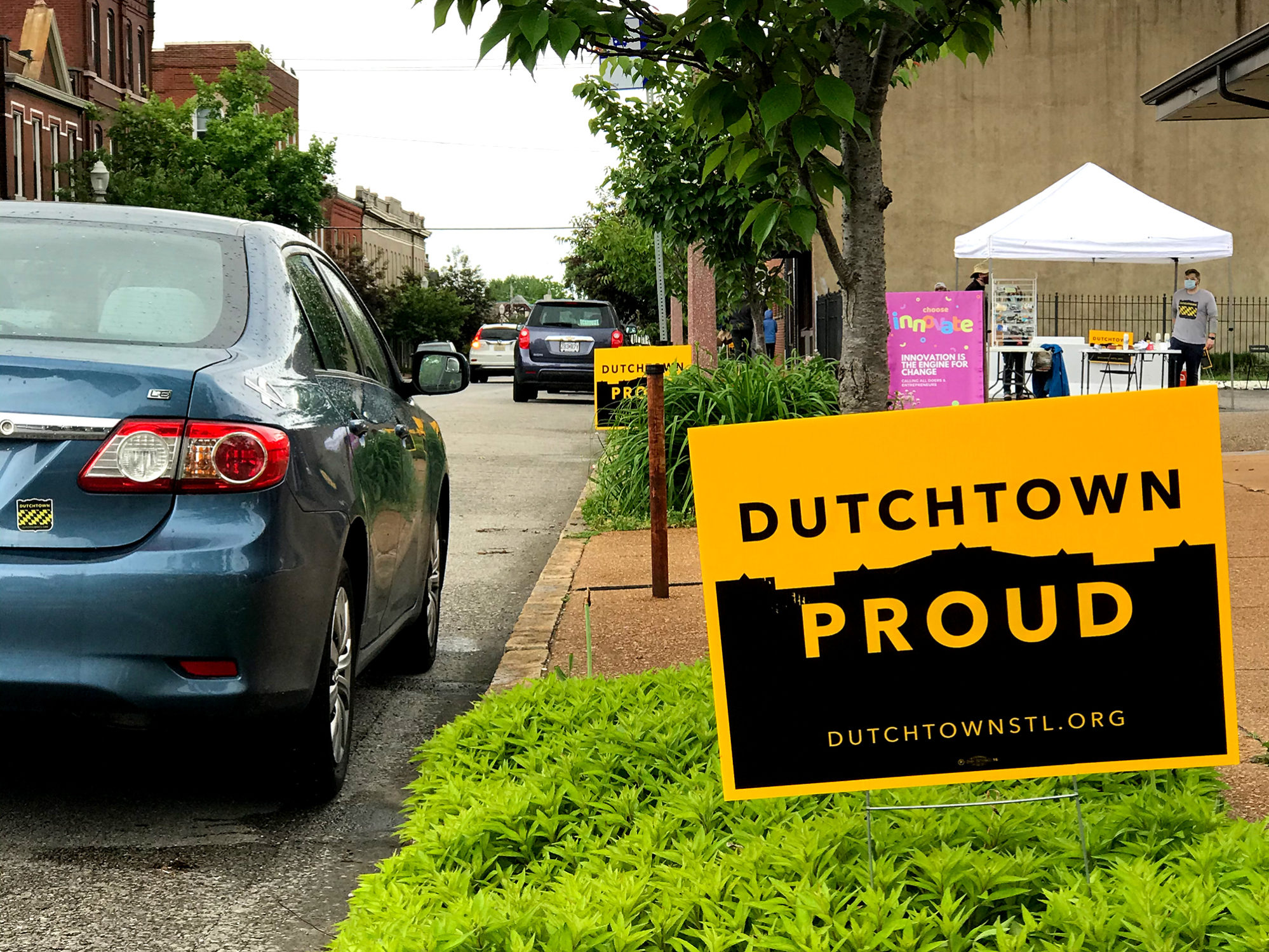 Dutchtown Proud signs in front of the Neighborhood Innovation Center in Downtown Dutchtown.