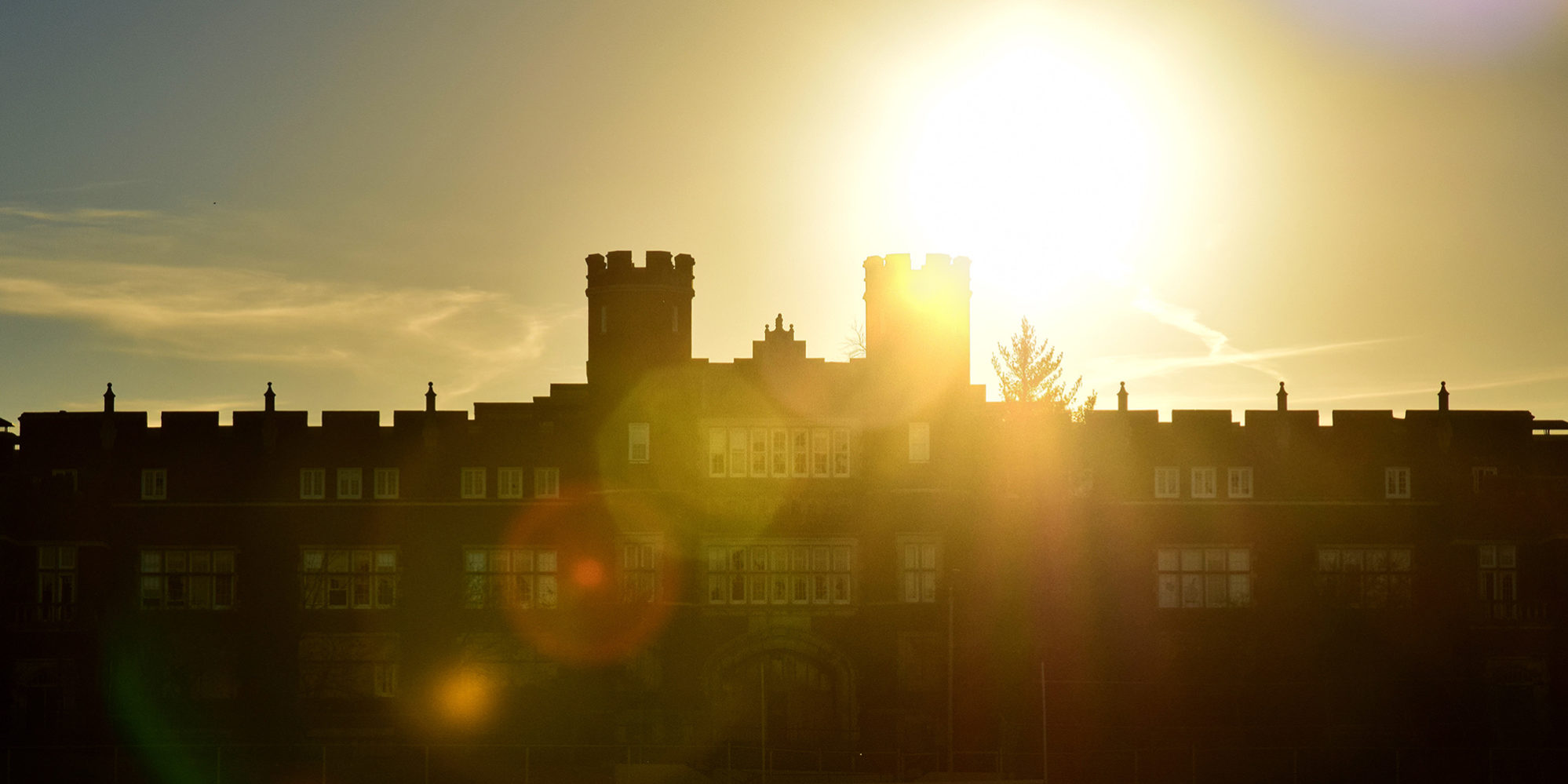 The sun rising behind Cleveland High School in Dutchtown, St. Louis, MO.