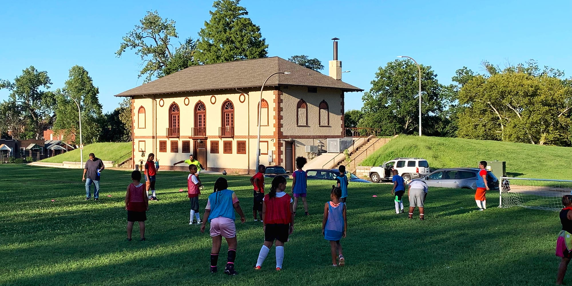 Children playing soccer at Marquette Park in Dutchtown.